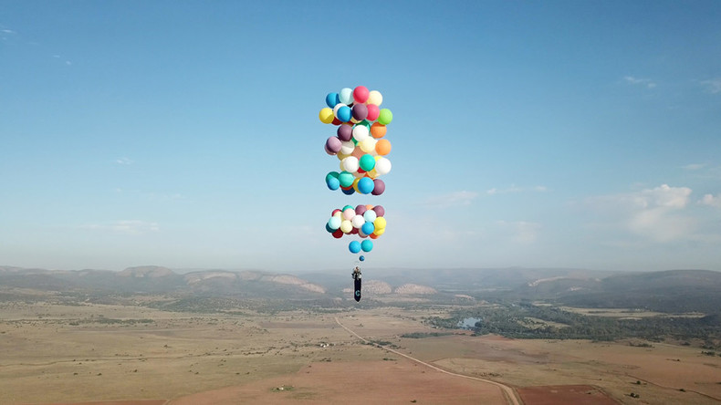 Daredevil dangles from deckchair tied to helium balloons 8000ft daredevil dangles from deckchair tied to helium balloons 8000ft above africa videos gumiabroncs Choice Image