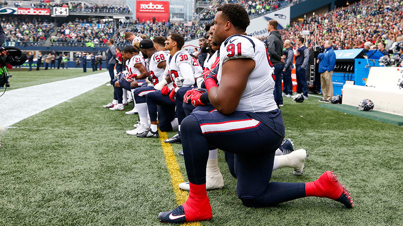 Almost entire NFL team 'takes a knee' in protest at owner's 'inmates' remark