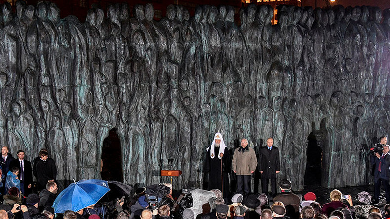 Putin says nothing can justify political persecution as Russia commemorates Stalin victims