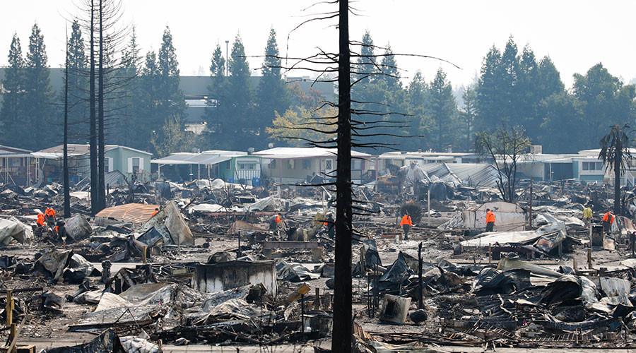 Earthquake rocks N. California, as burning wildfires kill at least 34