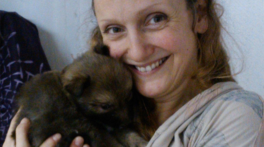 Artist who breastfed dog and fertilized her egg with dog cell wins prestigious prize