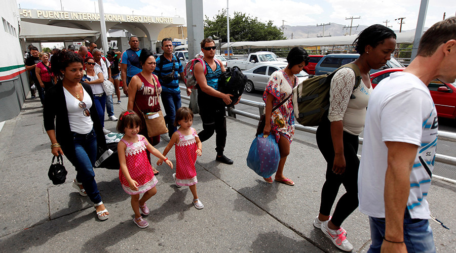 Trump signs executive order limiting refugee entry from 11 countries