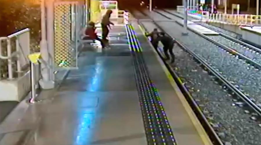 Horrific CCTV footage shows man drop-kicked off train platform (VIDEO)