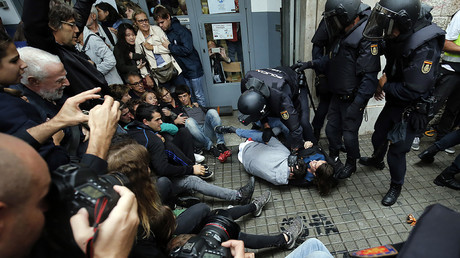 Catalans resist Spanish law enforcement as tensions mount on day of independence vote