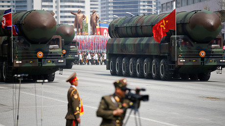 FILE PHOTO: Intercontinental ballistic missiles (ICBM) are driven past the stand with North Korean leader Kim Jong Un during a military parade in Pyongyang. © Damir Sagolj