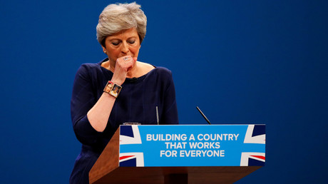 Britain's Prime Minister Theresa May coughs as she addresses the Conservative Party conference in Manchester, October 4, 2017 © Phil Noble