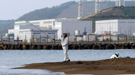 A man fishes near TEPCO's Kashiwazaki-Kariwa nuclear plant in Japan © Toru Hanai