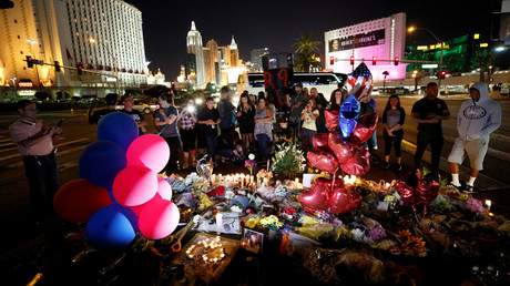 People gather at a makeshift memorial in the middle of Las Vegas Boulevard following the mass shooting in Las Vegas, Nevada, US, October 4, 2017 © Chris Wattie