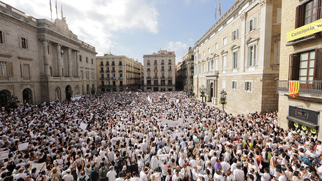All-white Catalan rally urges dialogue between Madrid and Barcelona