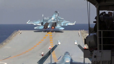 A Sukhoi Su-33 air superiority fighter of the Russian Aerospace Force takes off from the deck of Admiral Kuznetsov heavy aircraft-carrying missile cruiser in the Mediterranean Sea near Syria. © Sputnik