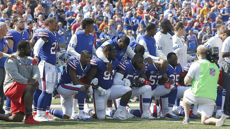 Buffalo Bills players kneel in protest during the National Anthem before a game against the Denver Broncos at New Era Field. © Timothy T. Ludwig / USA TODAY Sports