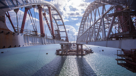 Russian engineers install 2nd massive arch of Crimea Bridge