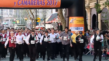 Ready, set, spill! Argentinians compete at waiters' race in Buenos Aires