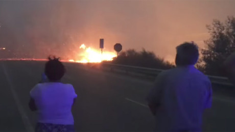 Spain's Galicia battles massive wildfires fueled by winds from Hurricane Ophelia