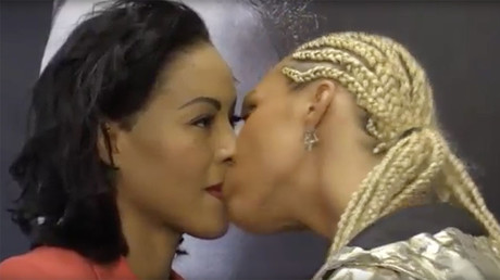Pucker punch! Female boxer plants kiss on opponent at press conference (VIDEO)