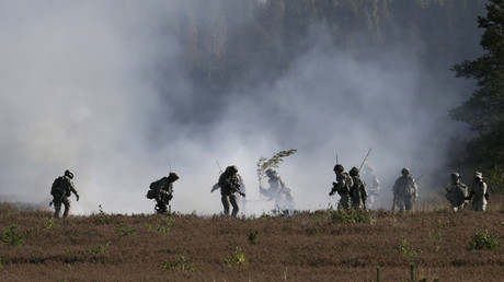 FILE PHOTO Latvian soldiers try to extinguish a fire during the