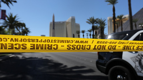 FILE PHOTO: Police crime scene tape marks a perimeter outside the Luxor Las Vegas hotel and the Mandalay Bay Resort and Casino, following a mass shooting at the Route 91 Festival in Las Vegas, Nevada, U.S. © Mike Blake