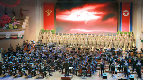 People perform for nuclear scientists and engineers who contributed to a hydrogen bomb test in North Korea © KCNA