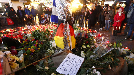 Flowers and candles are placed at the Christmas market at Breitscheid square in Berlin, Germany, December 22, 2016, following an attack by a truck which ploughed through a crowd at the market on Monday night © Fabrizio Bensch