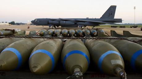 FILE PHOTO: Bombs wait to be loaded on to a B-52H long range bomber (BACKGROUND), part of the US Eight Air Force, at Barksdale Air Force Base in Louisiana © Pual J. Richards