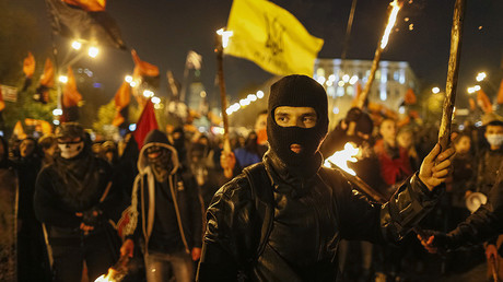 FILE PHOTO: Activists of the Ukrainian nationalist parties hold torches as they take part in a procession to mark the Day of Ukrainian Cossacks © Gleb Garanich