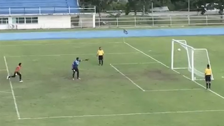 Goalkeeper celebrates penalty hitting crossbar, only for ball to bounce into empty goal! (VIDEO)