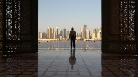 A man stands at Imam Muhammad ibn Abd al-Wahhab Mosque in Doha, Qatar © Naseem Zeitoon