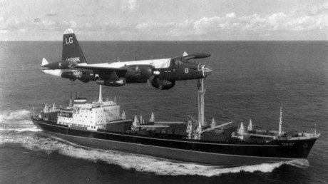 A US Navy P-2H Neptune of VP-18 flying over a Soviet cargo ship with crated Il-28s on deck during the Cuban Crisis. © Wikipedia