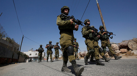 FILE PHOTO: Israeli soldiers patrol following a protest by Palestinians © Mussa Qawasma