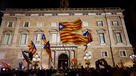 People celebrate and wave Catalan separatist flags in front of the Catalan regional government headquarters after the Catalan regional parliament declared independence from Spain in Barcelona, Spain, October 27, 2017 © Yves Herman