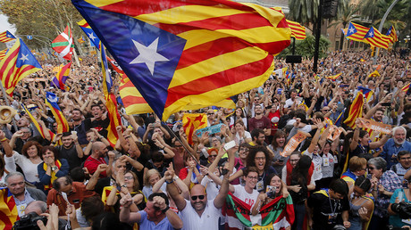 Pro-independence and pro-unity activists demonstrate as Catalonia votes for sovereignty