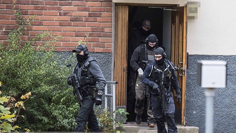 Man fires multiple shots at Swedish police officer's house with his family inside