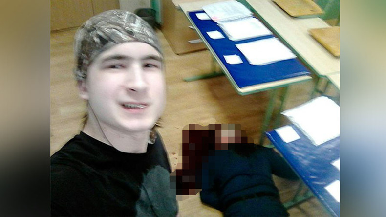 Moscow student posts selfie of himself standing over slain teacher's corpse
