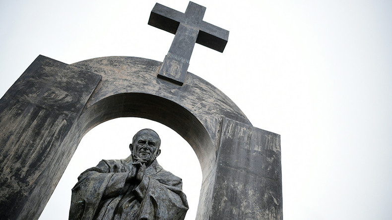 40K sign petition to 'defend the cross' on Polish pope's statue in France  %Post Title