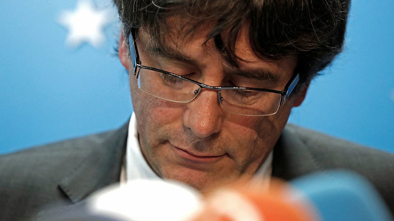 Ousted Catalan leader Carles Puigdemont hands himself in to police in Belgium