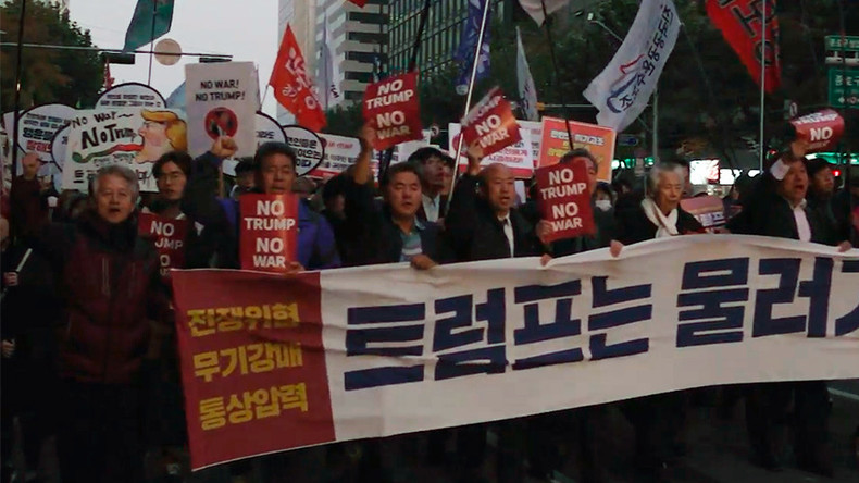 'No Trump, no war': 1,000s of South Koreans rally for peace ahead of US president's visit