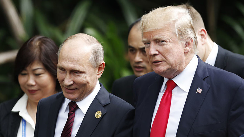 On the same page? Putin & Trump cross paths at APEC and chat cordially (VIDEO)