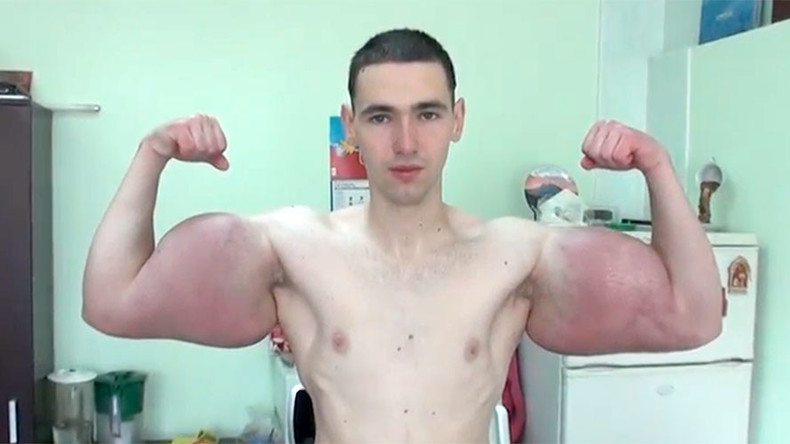 Russian showcases jaw-dropping foot wide biceps (VIDEO)