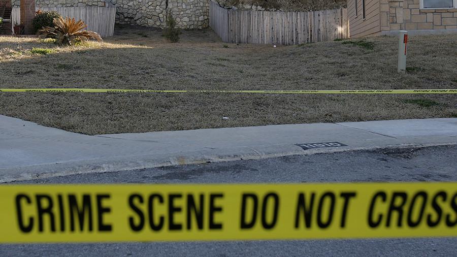 Baltimore neighborhood on lockdown as police hunt man who shot detective