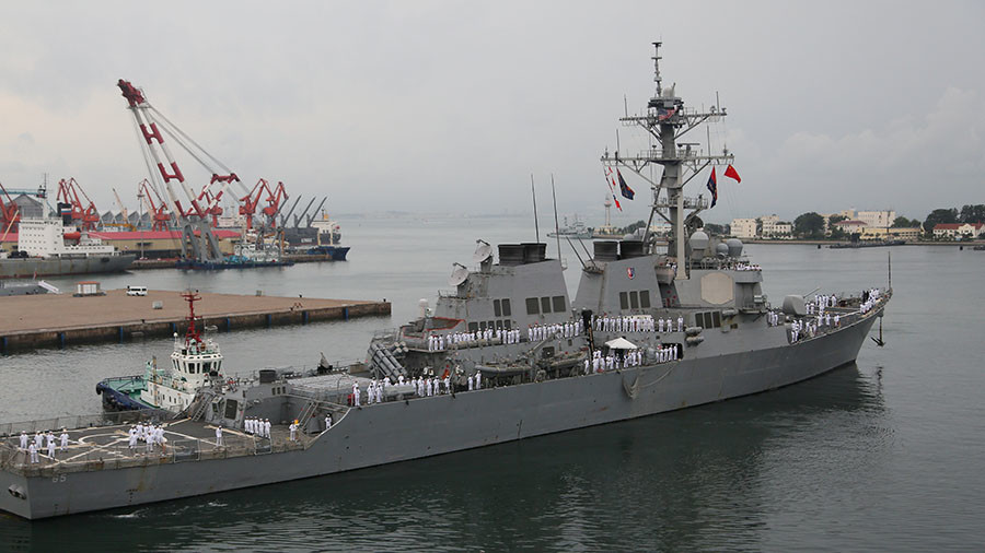 Japanese tug slightly damages United States destroyer