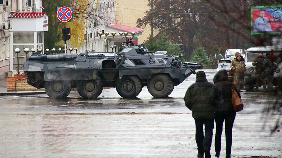 Armed standoff among leaders of Ukraine's breakaway region as Kremlin keeps close eye