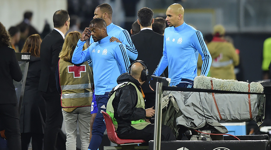 Kick off! French footballer red-carded for booting a fan in the head before game starts (VIDEO)
