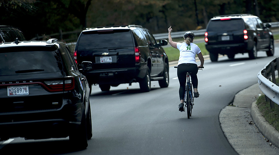 Woman fired for 'obscene' gesture aimed at Trump's motorcade