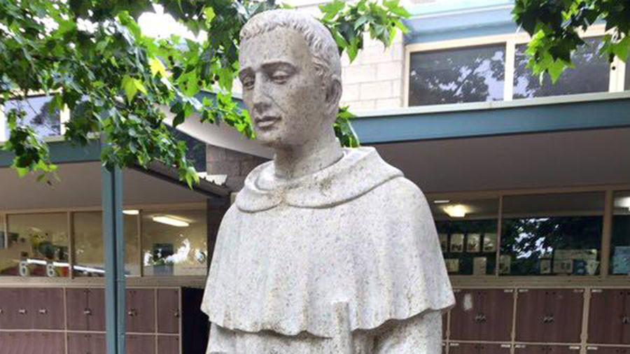 Bizarre cock-up of Catholic school's statue sparks apology (IMAGES)