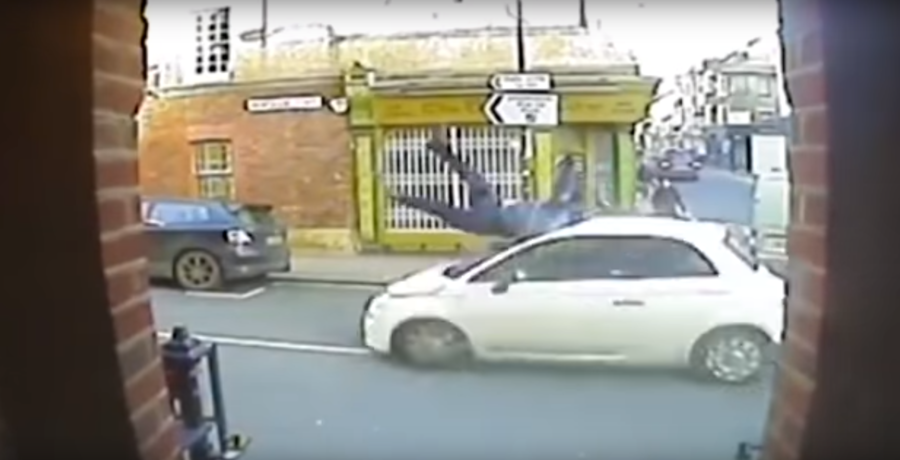 Hero cop stops overturned van from falling off bridge using only his bare hands (PHOTOS)