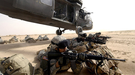 FILE PHOTO: U.S. Army soldiers from the 1st Brigade, 1st Armored Division, dismount a UH-60 Blackhawk helicopter during an air assault in the Al Jazeera Desert, Iraq © U.S. Air Force