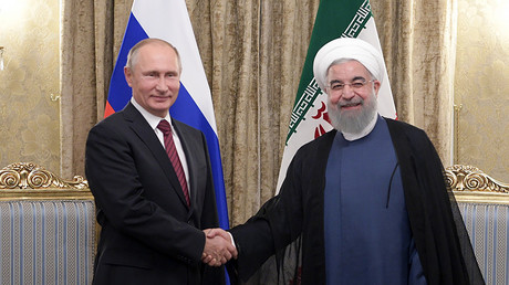President Vladimir Putin and President of Iran Hassan Rouhani, right, during a meeting in Tehran November 1, 2017.