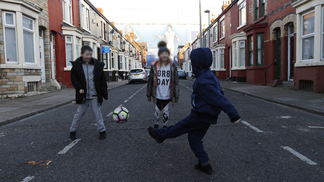 FILE PHOTO: Children play football in the streets © Reuters Staff