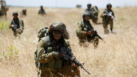 FILE PHOTO Israeli soldiers on the Golan Heights © Baz Ratner