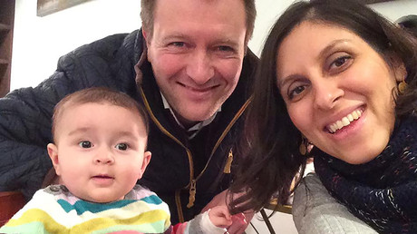 Nazanin Zaghari-Ratcliffe (R) posing for a photograph with her husband Richard and daughter Gabriella (L) © Free Nazanin campaign